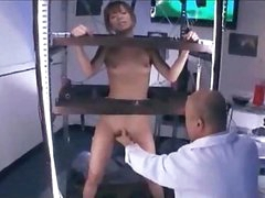 Asian Girl Standing In A Cage Stimulated And Screwed With Toys Getting Her Hairy Pussy Licked By Man In The Lab