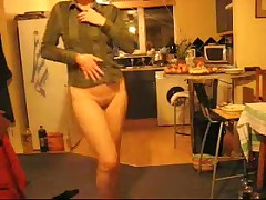 Mature housewife dancing with no pants in the kitchen at xmas.