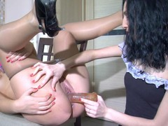 French maids in lacy pantyhose mastering their love techniques with a sex-toy