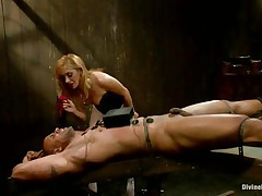 Mastix Lea enjoys playing with electricity and muscled guys. That babe takes her job very seriously and punishes her fellow like a real dominatrix. Her blonde hair, lascivious face and those sexy legs under her white pantyhose can make a fellow horny, especially when he's all tied up and with electrodes on his body.