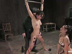 Vai is a hot brown haired milf who enjoys having electrodes all over her body during the time that this babe is tied up with bondage devices. That babe also has a ball gag in her mouth, because they know this babe is a screamer. That babe has a large time joy when Princess Donna Dolore takes a vibrator and starts rubbing on that bald pussy.