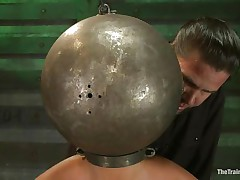 Adrianna Luna has her legs held apart by a support and her hands are encased by metal balls. Her head is encased by a metal ball as well and pumps on her nipples. She acquires a sex tool on her cunt and acquires the okay to cum. Then she's fastened to a table and having clamps put on her cunt and tits. Freaky!