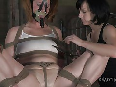 This is how these girls like to play. Cici is all bound up and has a mask on her face while her brunette hair hotty takes advantage of her body. That hottie squeezes her nipples and tongue and then starts rubbing that enchanting cum-hole with a vibrator.