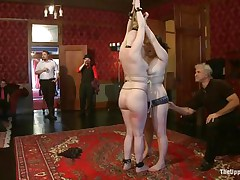 On the Upper Floor, girls all over the place are being punished. There's two tied up face to face getting caned, one more being flogged while holding a stripper pole, one more getting spanked by a fellow and her face slapped by a woman, one more getting her booty lashed with a whip, and one engulfing cock.