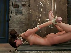 Take a look at these hot brunettes, one is tied up and the other one lubes her fingers and then waits until a guy ties the other chick neck. After this babe is completely immobilized the chick fingers hard that fur pie during the time that this babe takes a hard cock in her mouth. She's getting fucked in her face hole and twat in the same time and the fact that she's tied up is only increasing her pleasure, what a slut!