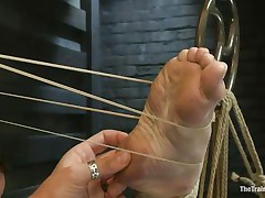 Melody Jordan is all tied up at the moment. She's getting screwed with one leg in the air and enjoying it also much, till a rubber band snap on the foot brings her back to earth. The position switches and now she's bent over with one leg in the air. The guy fingers and bonks her. This babe says thank u sir.