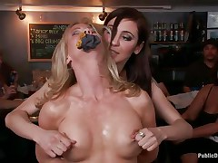 Blonde older Simone Sonay likes being punished in public places. This hottie likes having her legs fastened in a slavery device as this hottie stands. Watch her moaning with pleasure as Mark Davis and his allies are hanging a bucket to her labia in which they pour their drinks to make it heavier.
