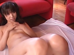 Breasty Oriental charms a throbbing pecker with wet engulfing